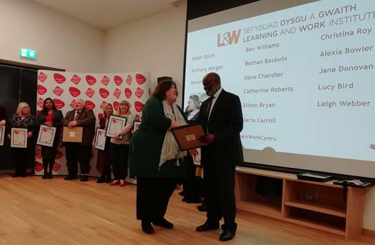 Alison Bryan receiving her award from Jeff Greenidge